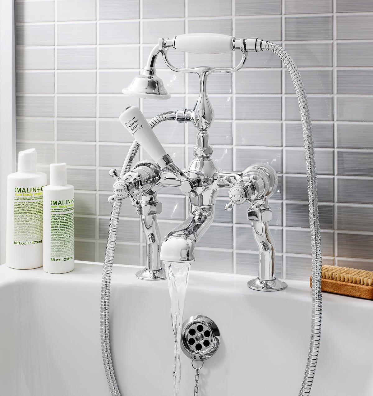 deck mounted shower bath tap flowing water