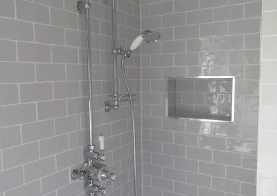Stylish Tiled Shower with Rain-forest Head