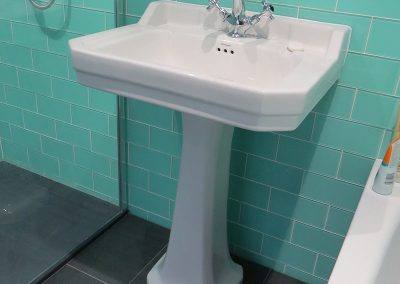 Traditional Sink with Green Tiles