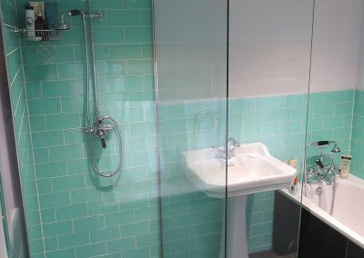 Great Use of Colour Tiles! Modern Shower with Traditional Sink