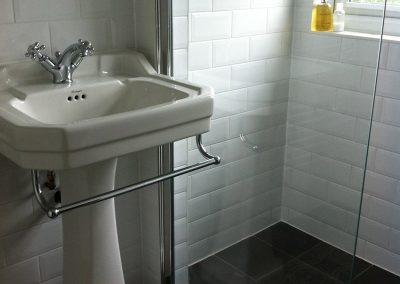 Traditional Sink with Tiled Shower
